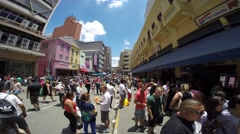 Time Lapse of Hundreds of People walk along the 25 March Area, Sao Paulo, Brazil - stock footage