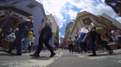 Hundreds of People walk along the 25 March area in Sao Paulo, Brazil Stock Footage