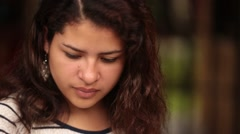 Beautiful Latina Woman Looks Up at Camera and Smiles - stock footage