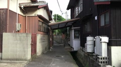 Handheld Point Of View Walking Down Streets Of Japanese Village 4K Stock Footage