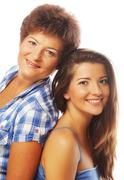 Stock Photo of happy mature mother ang adult daughter