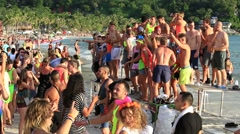 Girls and boys at Full Moon Party on Koh Phangan, Thailand. Dancing on the beach Stock Footage