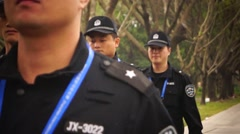 China's security guards on the streets - stock footage