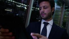 Middle Eastern male office night business insurance oil growth tablet technology - stock footage