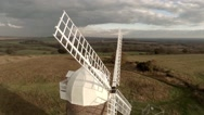 Stock Video Footage of Windmill - Flying front to back