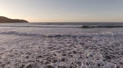 Stock Video Footage of Tracking shot of waves on a beach