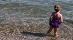 Little girl testing out the water Stock Footage