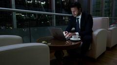Stock Video Footage of Caucasian European business male night developer traveller technology laptop