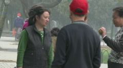 People converse in Beijing park Stock Footage