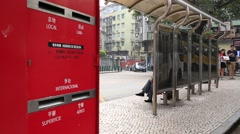 Red big postbox by bus stop in Macau, China - stock footage