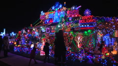 House with thousands of Christmas lights covering it Stock Footage
