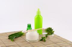 Aloe vera, cream and butter it on a bamboo plate Stock Photos