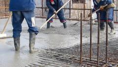 Concrete pouring at construction site - stock footage