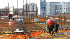 Construction workers installing reinforcement steel bars Stock Footage