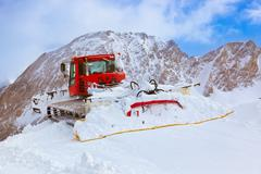 Machine for skiing slope preparations at kaprun austria Stock Photos