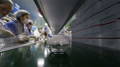 cosmotic creams on assembly line and busy working people - stock footage