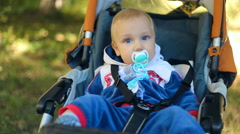 Child, cute little baby kid toddler boy in baby carriage outdoor Arkistovideo