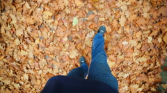 Autumn leaf fall. Steps of the person on autumn road - stock footage
