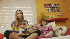 4K: Little Girl Playing Video Game with Sister Stock Footage