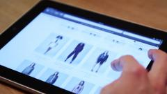 Browsing the online shop on ipad - stock footage