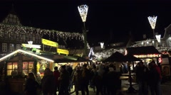 4k Yellow christmas tree at Christmas fair in medieval village Stock Footage