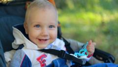 Child, little baby kid toddler boy smiling in baby carriage 002 Arkistovideo