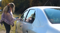 Woman motorist caring for a car (two frames) Stock Footage
