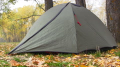 Camping Tent In Autumn Forest. Slider Shot. Stock Footage