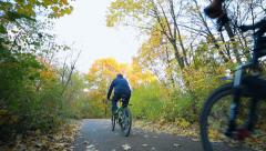 Family trip on a bicycle in autumn park Stock Footage