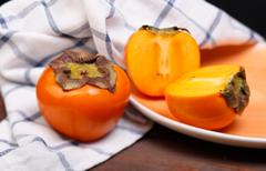 persimmons - stock photo