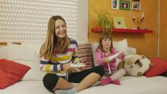4K: Sisters playing exciting game on wii Stock Footage