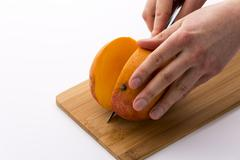 how best to cut a mango? - stock photo