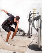 man exercise trunk-bending with twist, on  electro muscular stimulation - stock photo