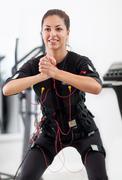 Woman exercise key position  on  electro stimulation machine Stock Photos