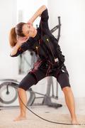 woman, ems electro muscular stimulation exercise - stock photo