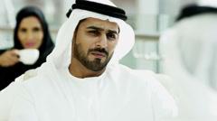 Stock Video Footage of Arab male female kandura abaya social leisure UAE hotel culture visitor coffee
