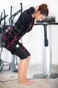 young woman exercise on electro stimulation machine - stock photo
