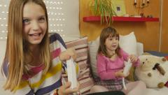 4K: Two cute Sisters Playing Wii Stock Footage