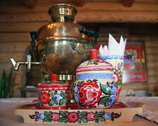 Russian tea drinking with samovar and traditional decorated wooden utensil Stock Photos