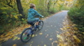The child boy teenager driving on a bicycle. Travel, Tour, trip and tourism. HD Footage