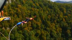 Stock Video Footage of bungee jump, men head down from the bridge with 207m