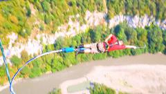 Bungee jump, a man with outstretched hand for shooting himself Stock Footage