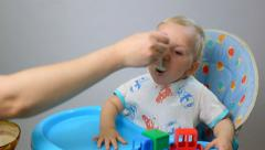 Child, little baby kid toddler eats  Stock Footage