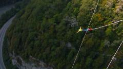 Bungee jump, men facing forward from the bridge with 207m Stock Footage