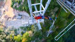 Bungee jump, men backwards off a bridge with a 207m Stock Footage