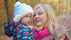 Child, little baby kid toddler communicates with mother on walk Stock Footage