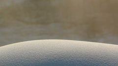 Snowdrift sunlit snow and dust in the background Stock Footage