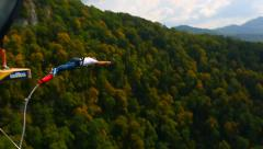 Bungee jump, men from the bridge with 207m Stock Footage
