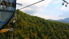 Girl jumping into the gorge from 207m Stock Footage