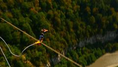 Girl jumping in the gorge Stock Footage